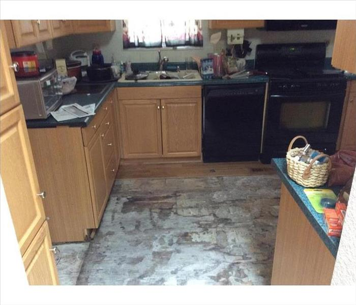Water damaged kitchen with finished flooring removed