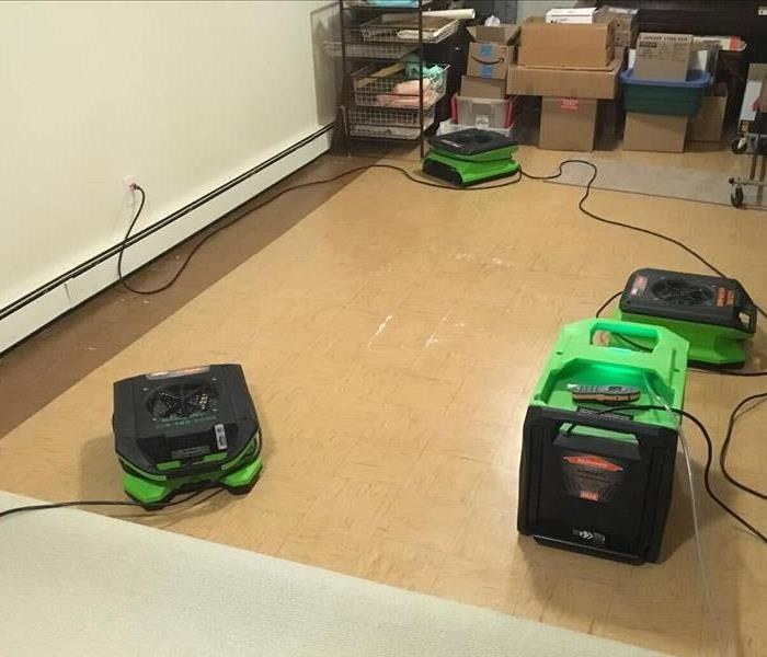 Air movers and dehumidification equipment deployed in an office with vinyl tile flooring