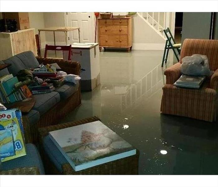 Storm water pooled about 1 inch deep on the floor of the family room of a home