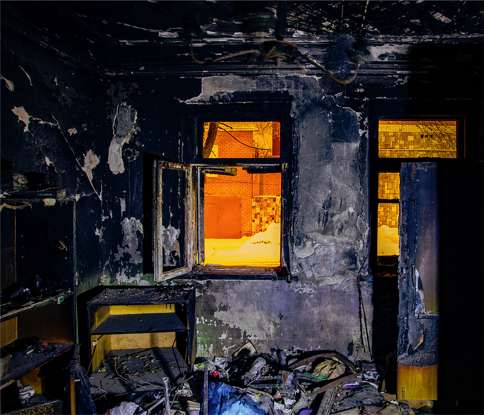 fire damaged room with burnt interior